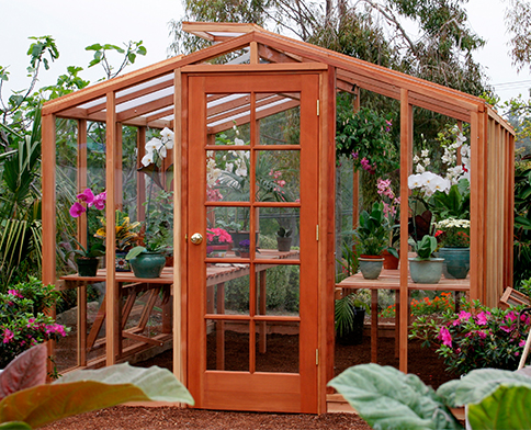 DIY greenhouse kit with California redwood framing and glass paneling.