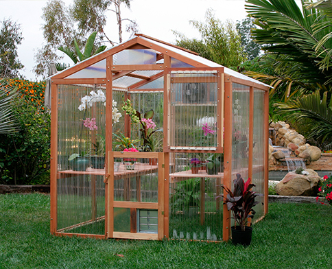 Our DIY redwood greenhouse kits are a beautiful addition to any backyard.
