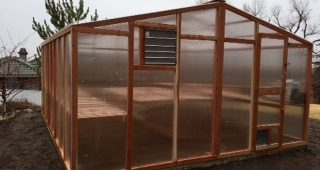 DIY greenhouse kit made with California redwood and premium polycarbonate paneling.