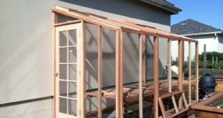 Redwood lean-to greenhouses are ideal for small backyards.