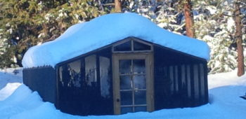 One of our redwood backyard greenhouse kits in the snow.