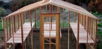 Beautiful redwood greenhouse kit overlooking valley and mountains.